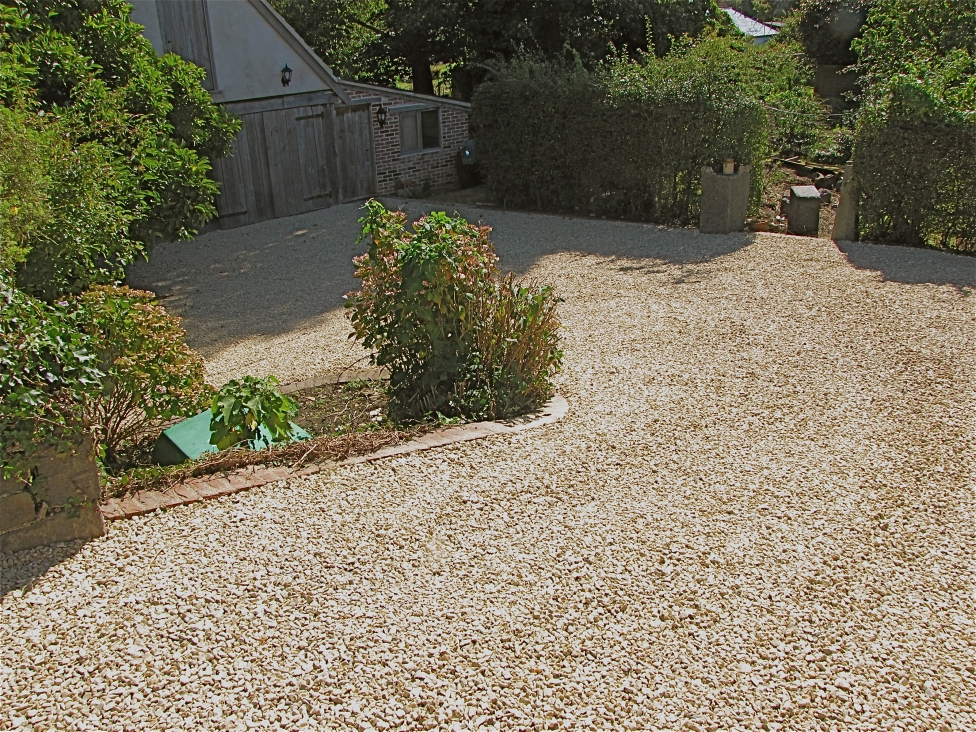 Permeable paving driveways cheaper greener better for Sloped driveway options